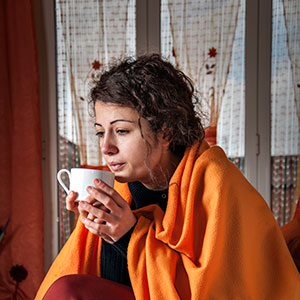 Woman Drinking Herbs To Fight The Flu