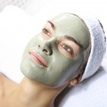 woman with green herbal face mask