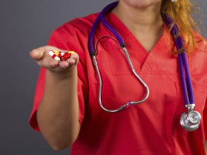 Nurse holding pills