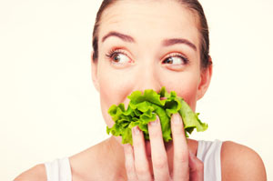 woman eating raw lettuce