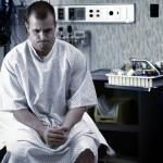 man waiting in hospital examination room