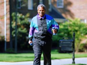 Man on brisk walk through neighborhood