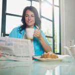 Woman having breakfast at home