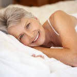 Smiling Middle Aged Woman in Bed