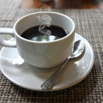 Hot Black coffee in a white cup on the table