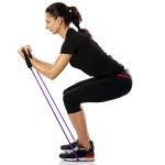 Woman exercising with a resistance rope
