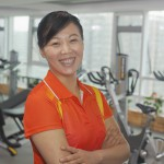Mature woman standing in the gym