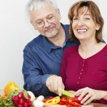 mature couple cooking healthy