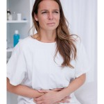 Woman at doctor's office with stomach pain