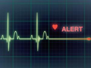 Heart beats cardiogram on the monitor