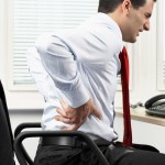 Businessman with low back pain