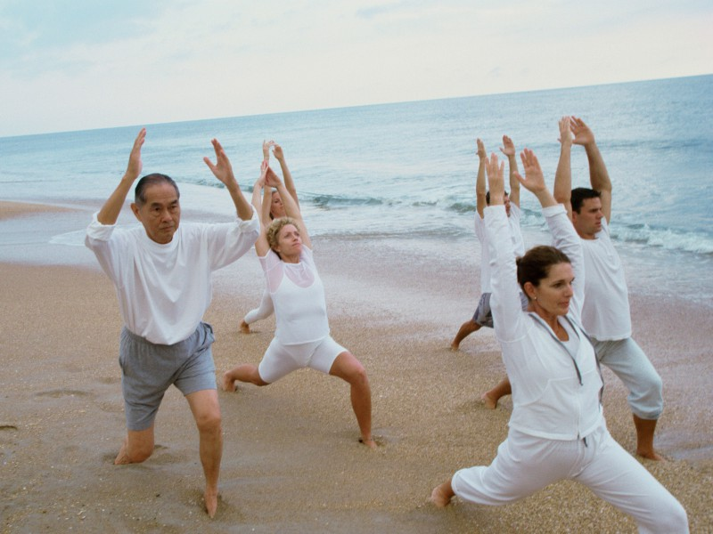 Group exercising on the beach