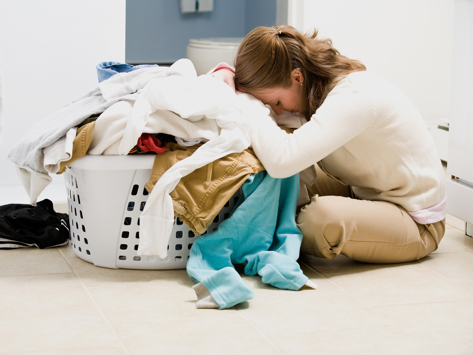 Woman with chronic fatigue syndrome doing laundry