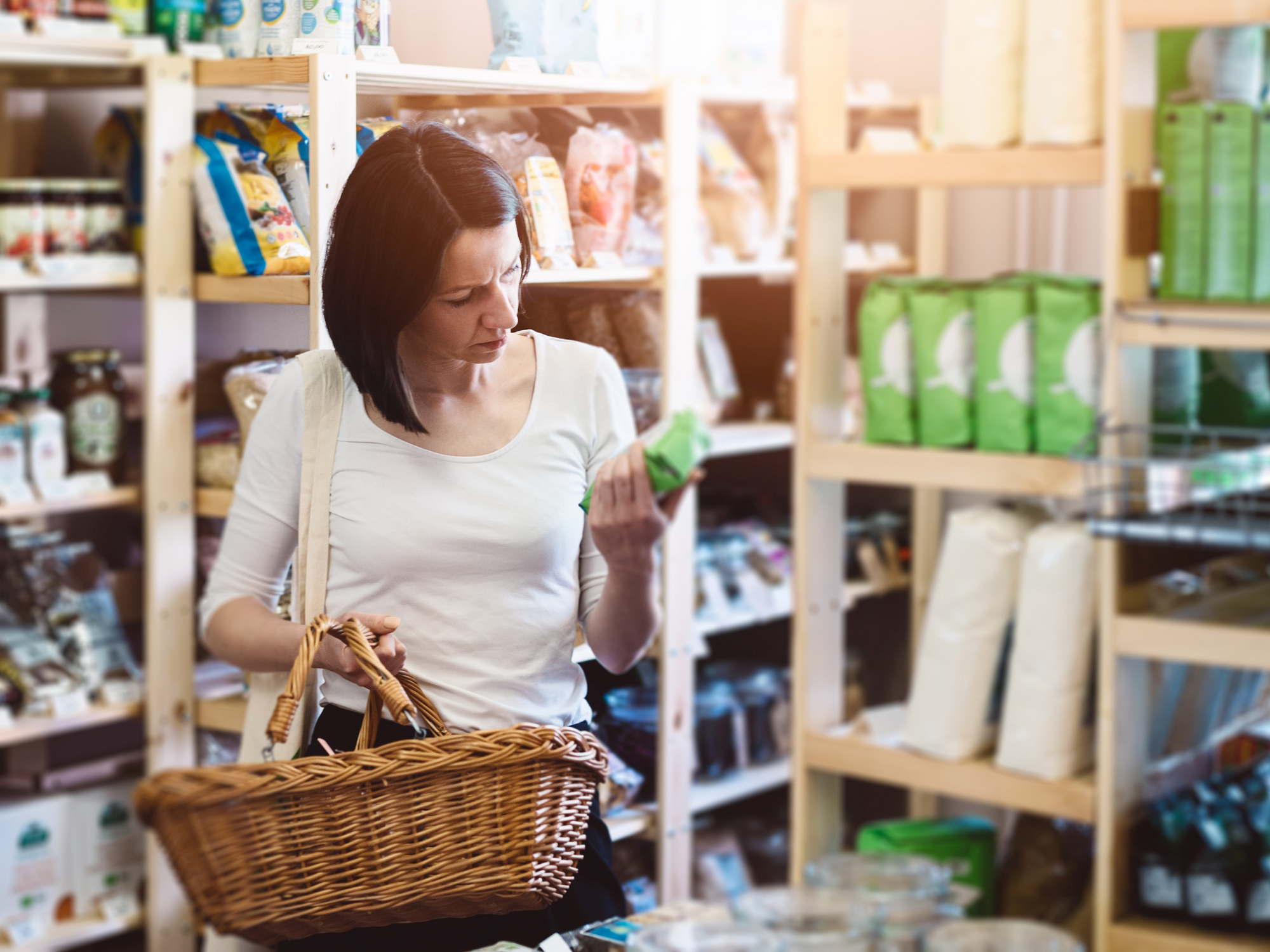 Woman looking at label in store