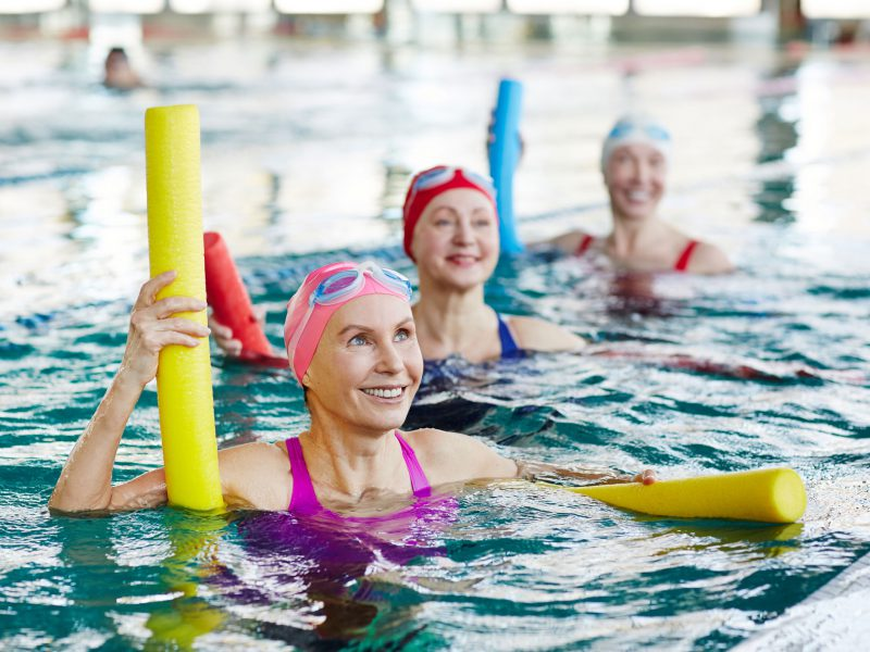 Mature women exercising in the pool.