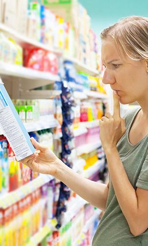 Woman reading ingredients list