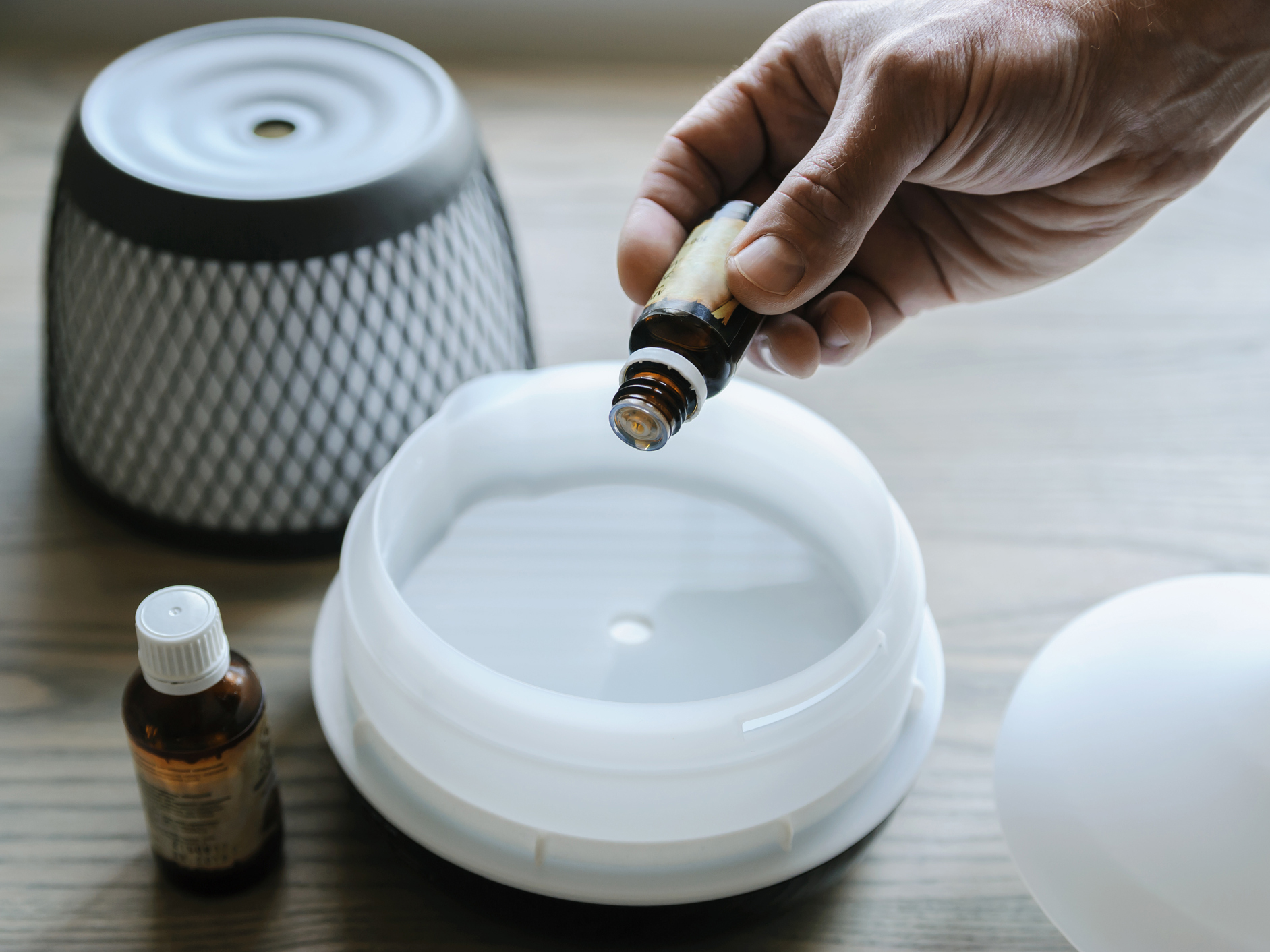 Adding essential oils to a diffuser
