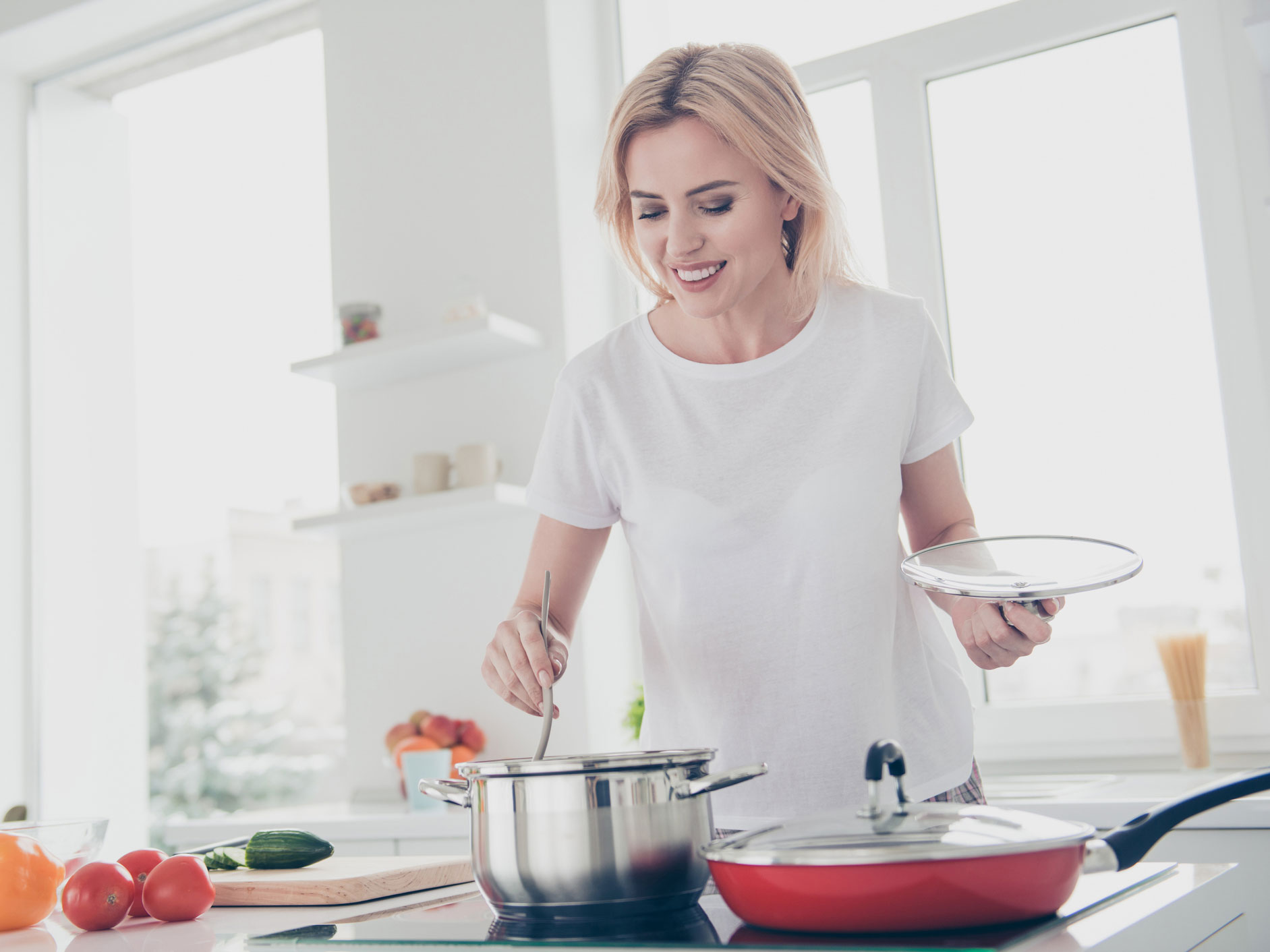 Woman cooking soup