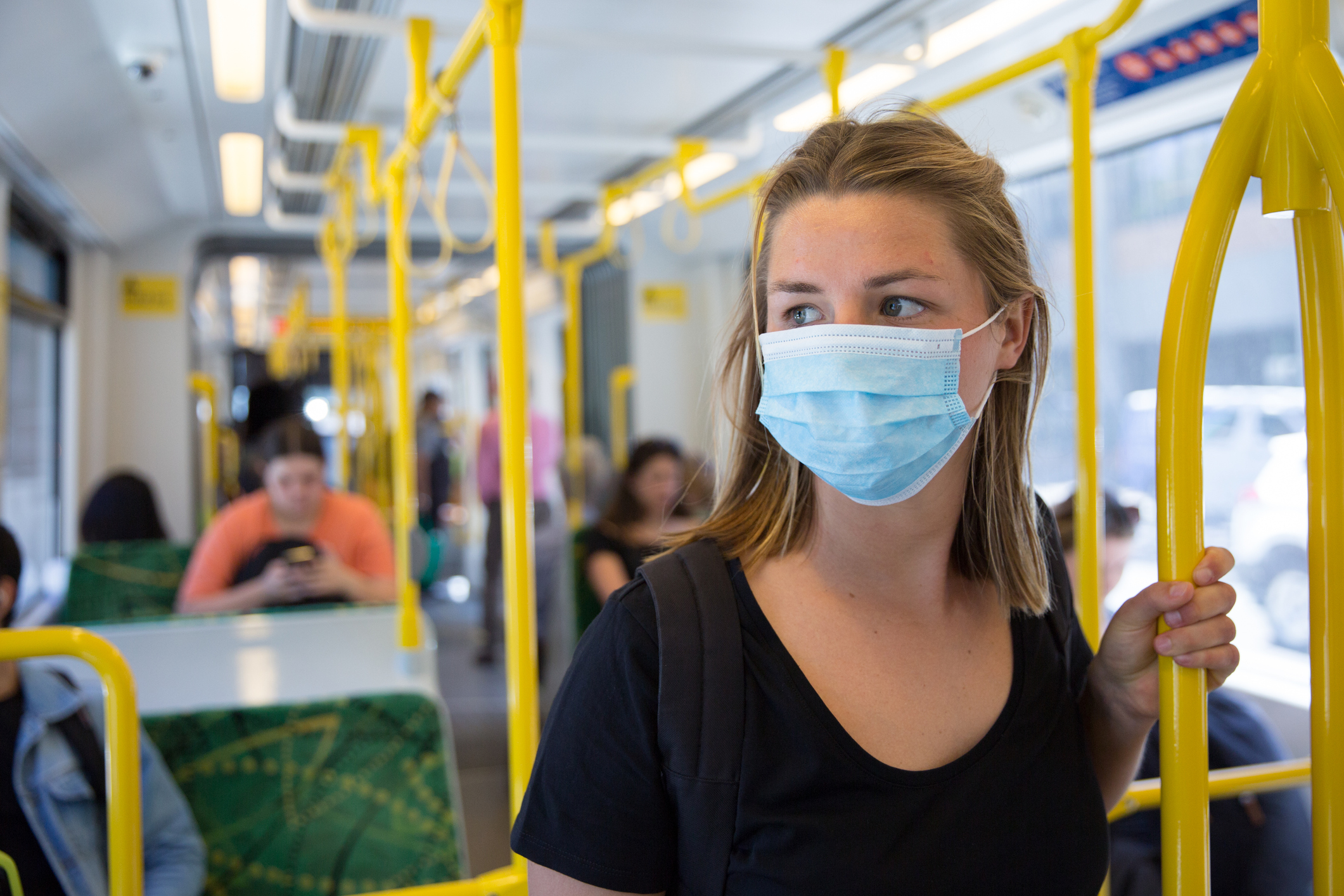 girl in facemask on the bus