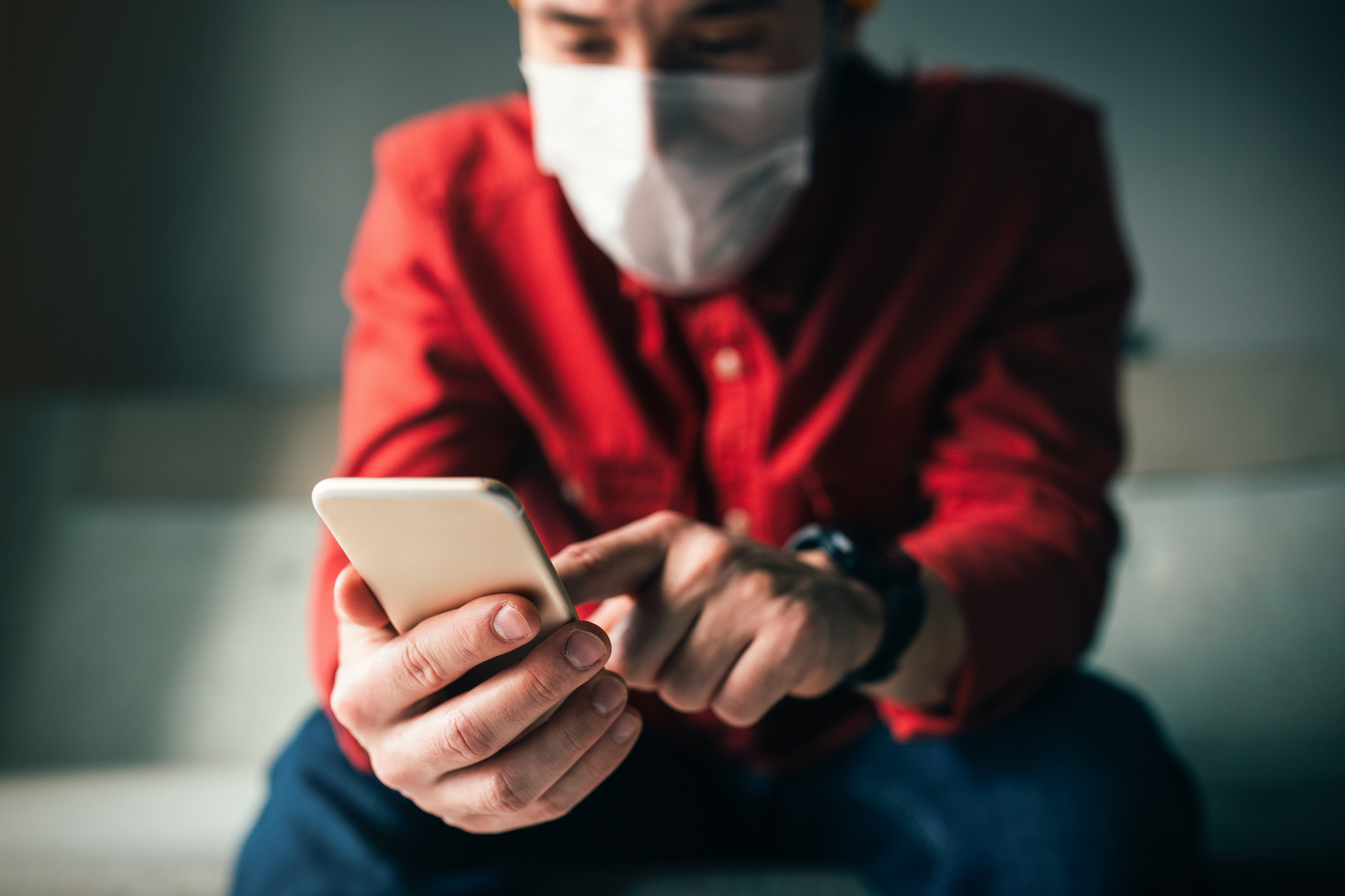on phone with mask